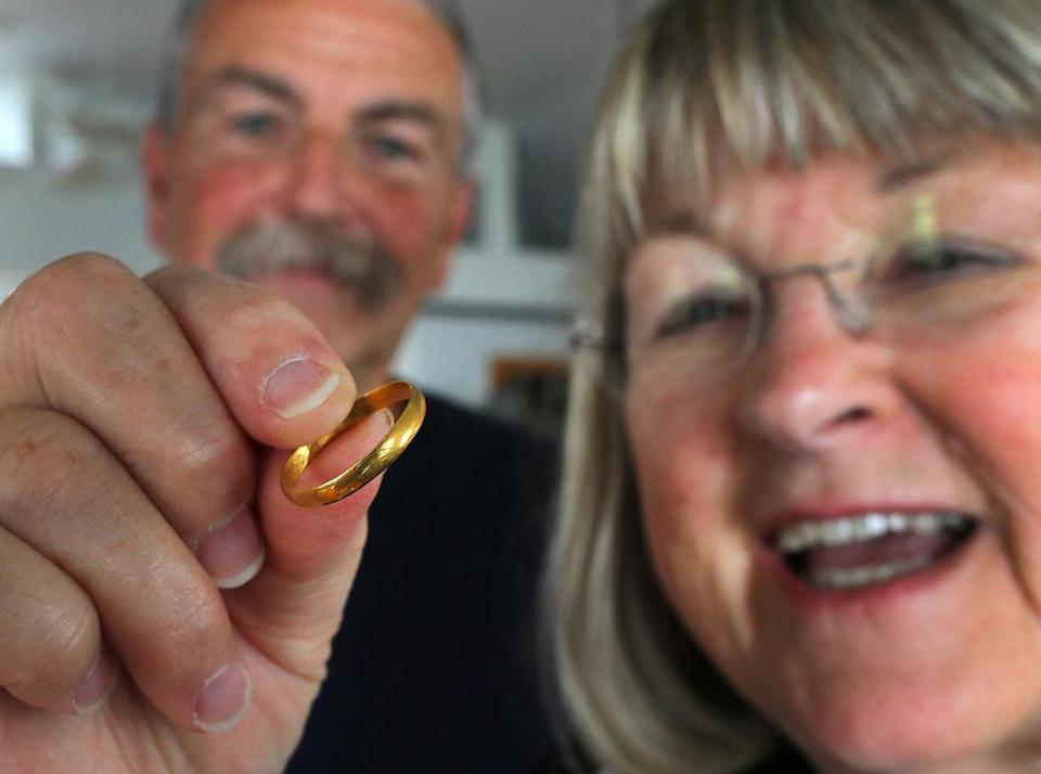 Gayle Griffiths Fraser held the ring, which she gave to Dan Dixey (left).